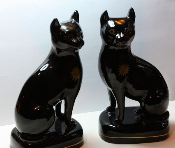 A pair of black Staffordshire cats